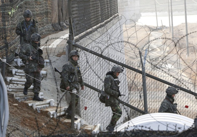 "A top NKorean decision-making body issued a pointed warning Sunday, saying that nuclear weapons are ""the nation's life"" & will not be traded even for ""billions of dollars""--South Korean Army soldiers patrol along a barbed-wire fence near the border village of Panmunjom in Paju, South Korea, Sunday, March 31, 2013."