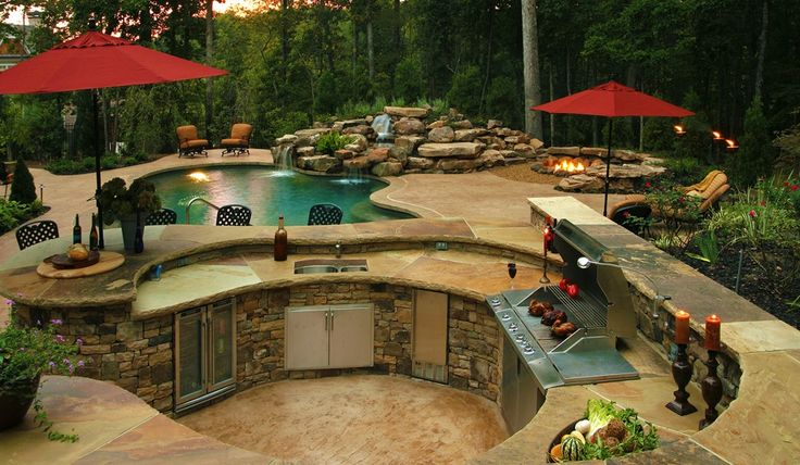 Outstanding Curved Outdoor Kitchen With Stainless Steel Grill Also Red Umbrella Plus Gorgeous Free Form Pool With Waterfall - Designing City