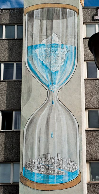 Global Warming Hourglass mural by BLU in Berlin, depicting how we're running out of time preventing glacier loss and sea level rise. (image persective altered from original photo)