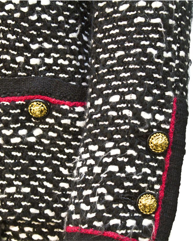 Exquisite 1970's haute couture black and white boucle short sleeve dress with fuchsia trim complimented with a classically tailored Chanel jacket with lions head buttons, patch pockets and matching fu