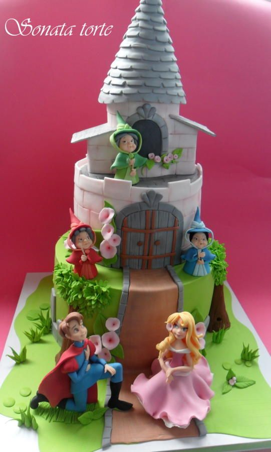 Princess Aurora in her pink dress with flora, fauna and merriweather (and the prince) cake.