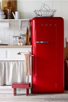 You've probably noticed diners have a lot more old-school appliances than you do. A 1950s-style Smeg refrigerator will certainly add decorative charm—and a welcome pop of color—in a small kitchen. But since those big-ticket appliances have hefty price tags, you may also want to consider smaller gadgets like a Smeg toaster, a popcorn machine, a vintage can opener, an ice cream maker, or a pop-up hot dog toaster. (Yes, the last one is a real thing.)