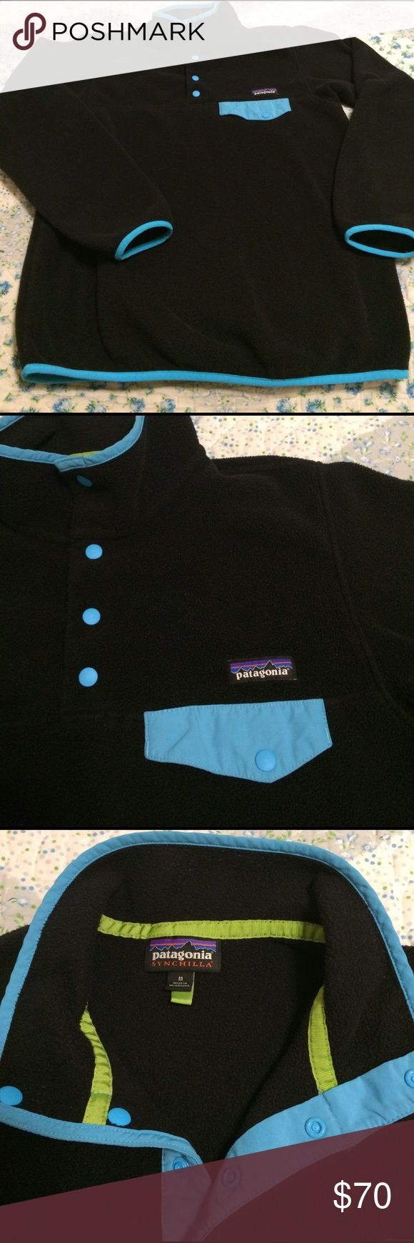 Patagonia Synchilla Fleece Pullover EUC classic Patagonia Synchilla Fleece Pullover. Men's Medium/Women's Large. Black body with bright turquoise contrasting pocket flap & trim. Extremely comfortable and provides just the right level of warmth for cool weather hikes or for layering when hitting the slopes. The interior material/care tag has been cut out. Aside from that--excellent shape!! Patagonia Jackets & Coats