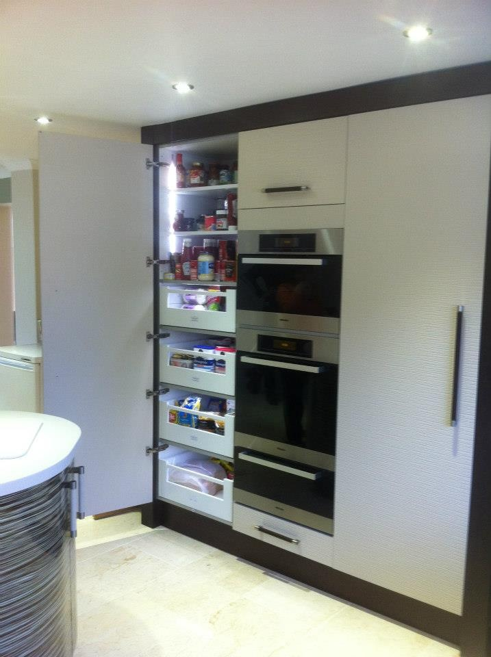 The lights in this drawer larder unit not only looks great but increases practicalities.