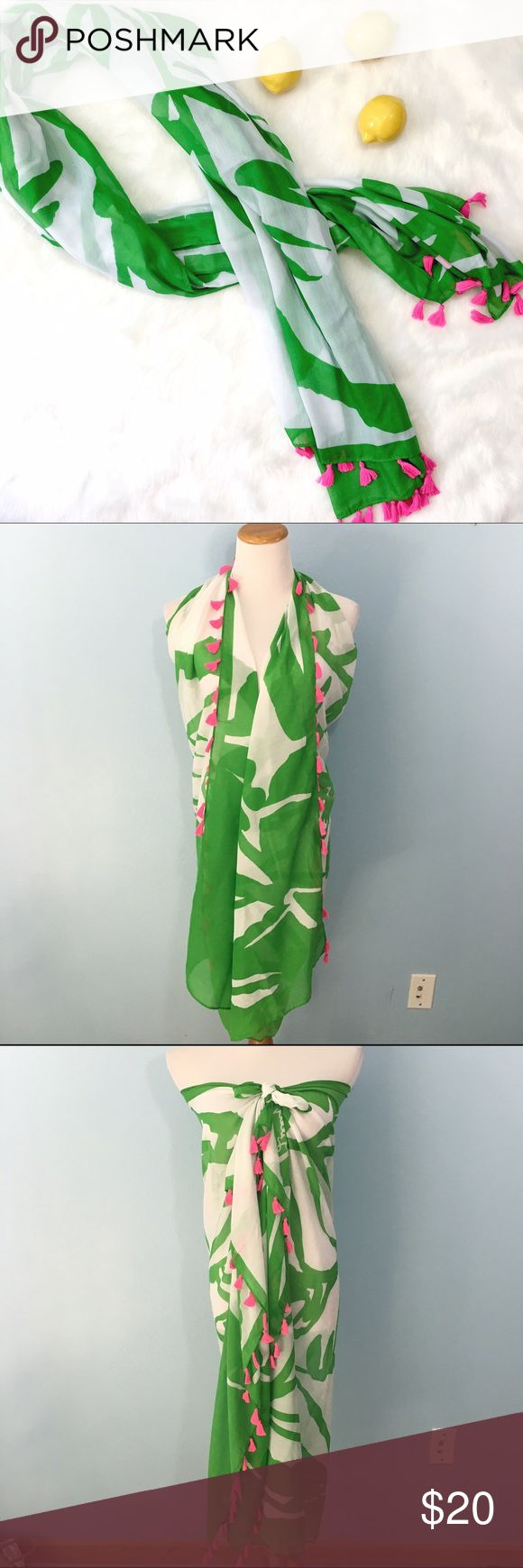 """Lily Pulitzer Large Oblong Scarf with Tassles So versatile! Very large, measures 68"""" x 43"""" with a gorgeous palm print across it. Sassy pink tassels bobbing along with your warm weather adventures! Large enough to be worn as a vest or wrap, perfect coverup! Lilly Pulitzer for Target Accessories Scarves & Wraps"""