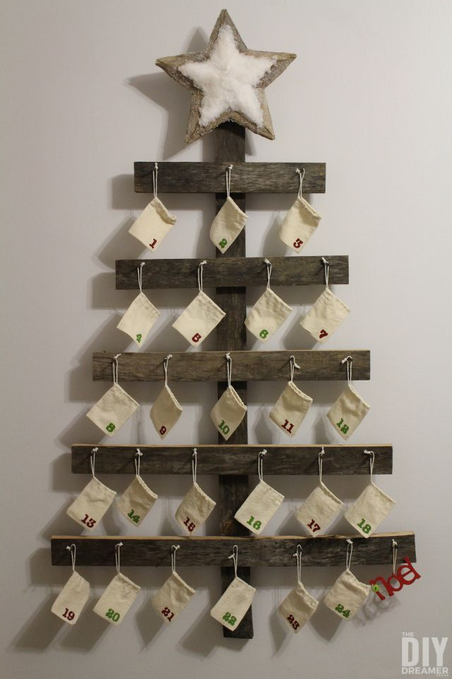 Rustic Advent Calendar. Giant Wall Mounted Advent Calendar perfect for a Rustic Christmas. This DIY advent calendar is over 4 Feet tall. Beautiful addition to your xmas decor. Follow this step by step tutorial so that you can make one for your family! | thediydreamer.com