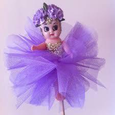 Image result for carnival kewpie dolls on a stick