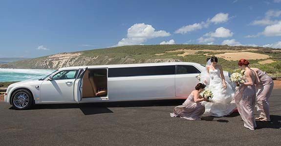 10-Passenger-middle-door-White-Chrysler-Limo-Hire-Perth-at-beach-wedding-pic-perth-wicked-limos-perth