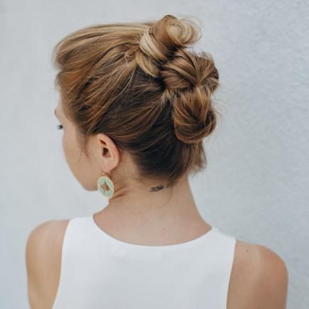 Side Walk Ready provides a great hair tutorial for this triple-stacked bun. This easy updo works for all hair lengths and the buns are tight, it makes an excellent hairstyle for prom.