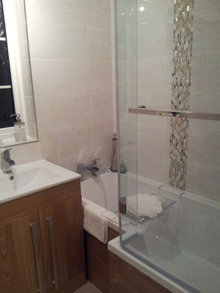 Anne Marie from Northampton has a modern bathroom with wooden finished bathroom furniture and lovely shower bath. #VPShareYourStyle