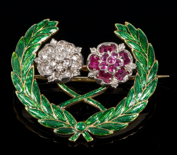 Gold, enamel and gem-set wreath brooch with two English roses set with rubies and diamonds within a green enamel laurel wreath. (Reeman Dansie)