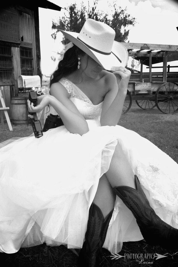 rustic wedding inspiration, rustic wedding ideas,  cowboy hat, wedding dress, bride in a cowboy hat, bridal photos, wedding photos, rustic wedding pictures, barn wedding, barn wedding ideas, bride with a gun, wedding dress and cowboy boots, gator boots, cowgirl bride