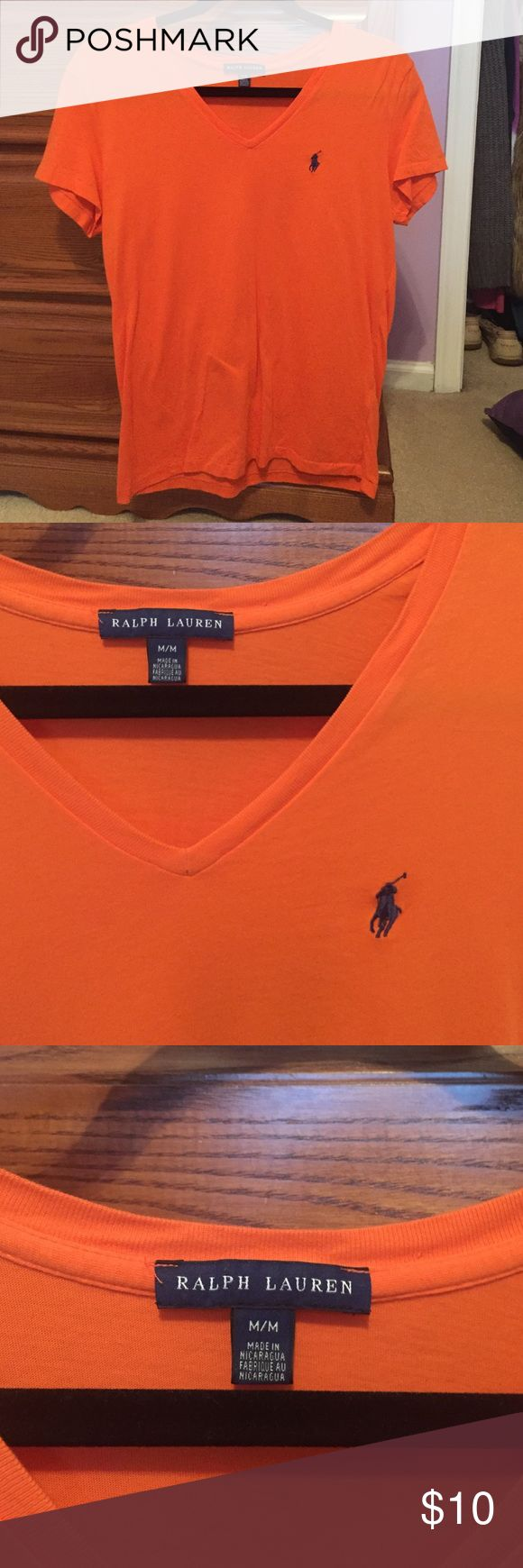 Orange Ralph Lauren POLO V-Neck T-Shirt Like New Ralph Lauren POLO orange V-neck t-shirt. Only worn once. No holes/rips/stains. Navy blue POLO symbol on front left side. Women's Size medium. Polo by Ralph Lauren Tops Tees - Short Sleeve