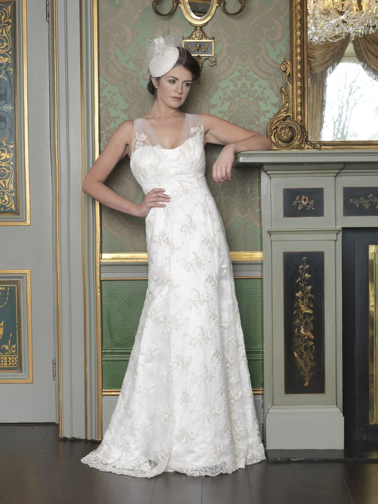 Lace wedding dress, empire line with tulip flow. Rolled strap with beaded finish. Taken from 2015 wedding collection by Ginan Abbas. www.goldenstitch.ie