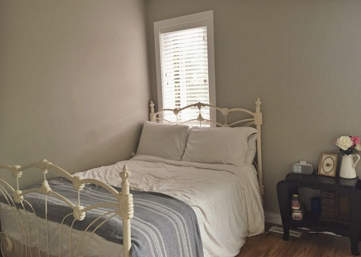 vintage bed frame and white sheets