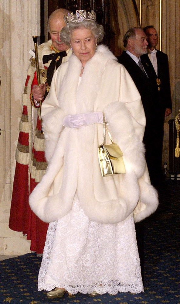 November 1998 | London must be chilly in November! The Queen wore this large fur coat as she left the House of the Lords. via @stylelist