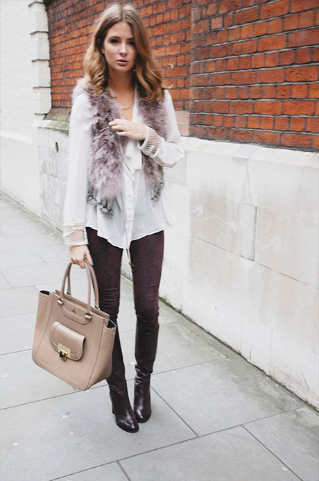 CASUAL CHIC: burgundy trousers; nude bag; white shirt; faux fur waistcoat