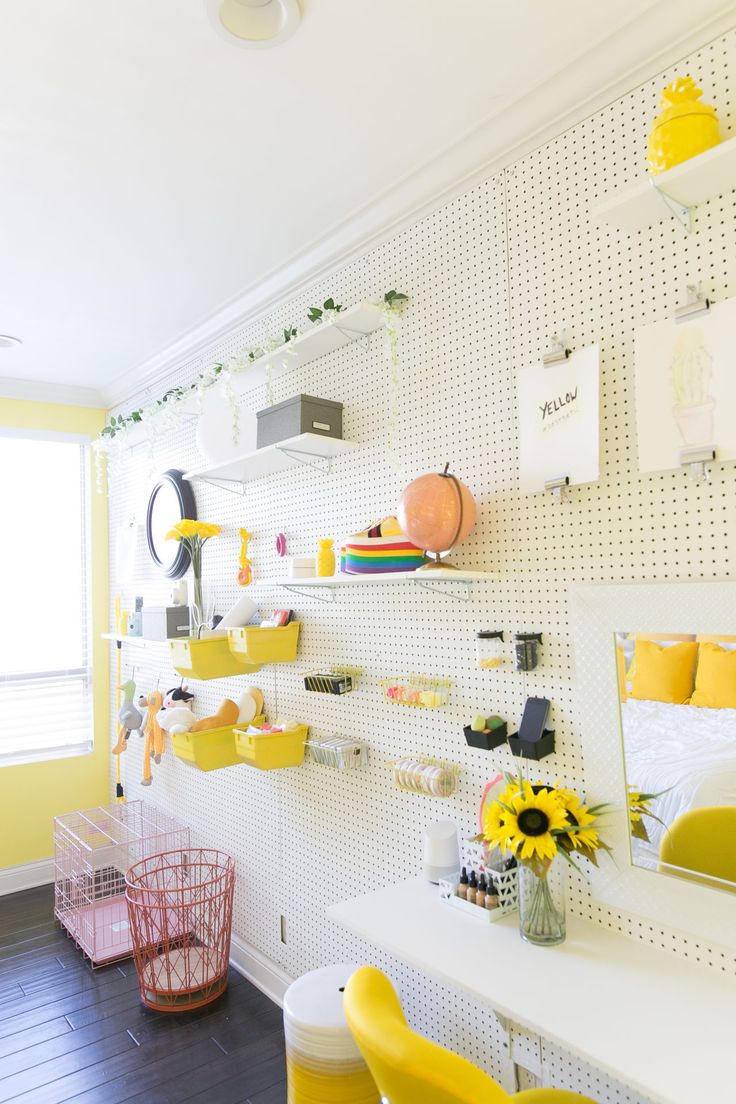 Modern, modular storage is a key part of the design with this DIY-able pegboard wall!