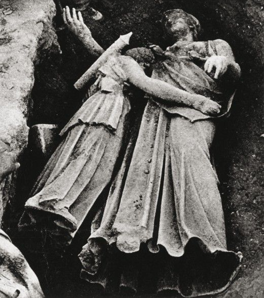 The statue of Artemis hanged with the statue of Athena, as found in 1959