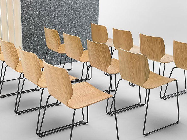 Nim 1.1 from Sandler Seating, designed by Yonoh Studio. Veneered wood chair on a steel sled base.