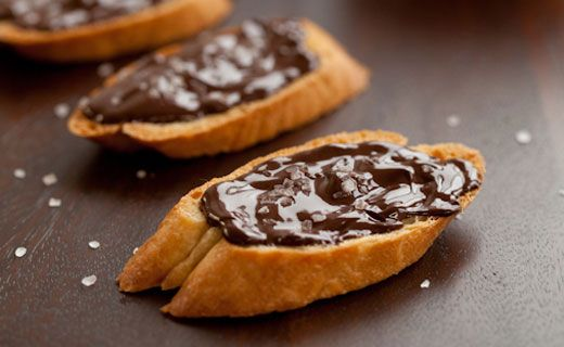 Bread and chocolate is a common after-school snack for children in Spain. Add olive oil and sea salt to turn these little bites into a grown-up affair.