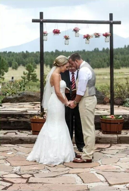 rustic chic wedding with our DIY wedding arch. Arch at the end.