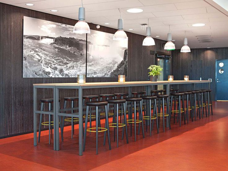 Audrey bespoke wood stools with leather upholstery at Malmö university