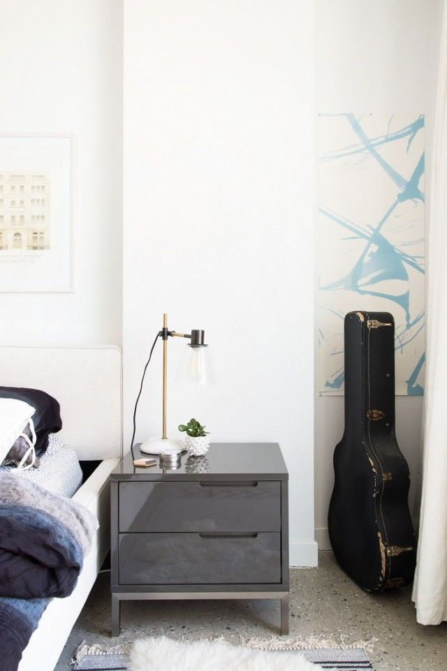 Edgy bedroom with a gray side table