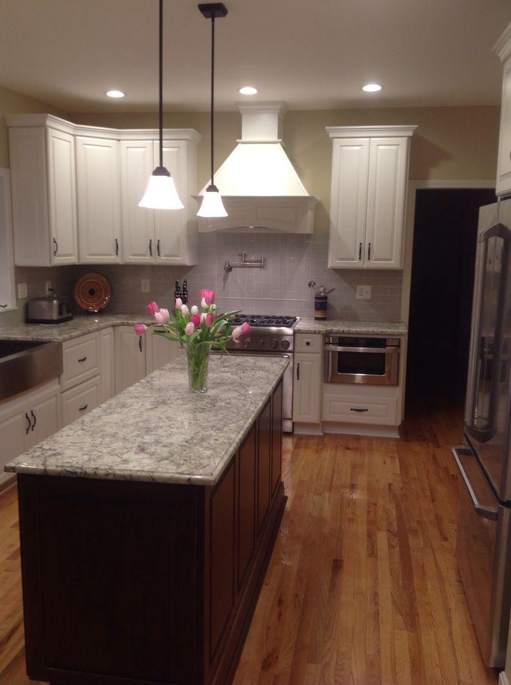 White ice granite with cherry cabinets my kitchen re do for Cherry and white kitchen cabinets