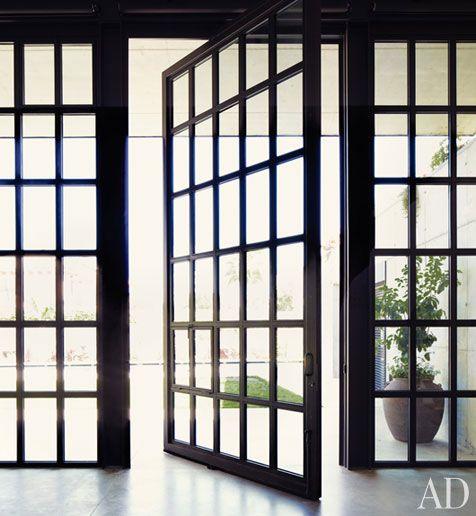 pivot door: The Doors, Idea, Living Rooms, Front Doors, Industrial Style, Glasses Doors, Architecture Digest, Window Frames, Pivot Doors