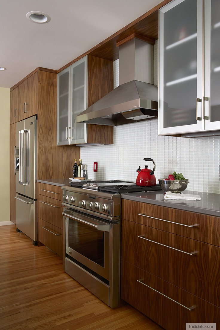 Walnut with quartz countertop, GE range. Frosted
