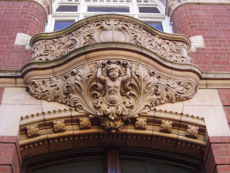 Detail of the terracotta ornamentation on the facade of the late 19th century Barclay's Bank building in Nuneaton town centre.  Uploaded originally for the 'Guess Where UK?' Group.