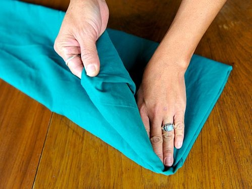 How to fold a fitted sheet.  I vow to have a completely organized linen closet sooner rather than later...