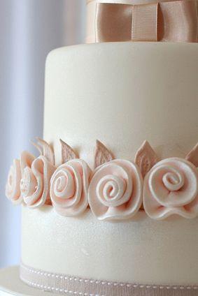 Fondant ribbon-style roses on a wedding cake, from Rachelles Beautiful Bespoke Cakes.