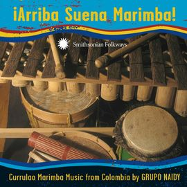 ¡Arriba Suena Marimba! Currulao Marimba Music from Colombia by Grupo Naidy - Hailing from small towns along the river-ridden Colombian coast, the seasoned women singers of Grupo Naidy raise their voices to the accompaniment of marimba and drums, performing their unique styles of music known collectively as currulao.
