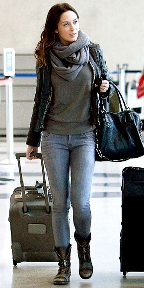 Moto boots and leather jacket - edgy #airplaneoutfit and #traveloutfitEmily Blunt airport style