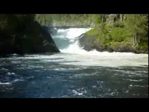 rafting boat captured by waterfall in Oulanka National Park