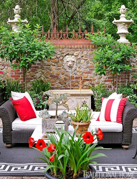 Lovely couryard terrace of Kansas City interior designer John Rufenacht, whose favorite color is red.