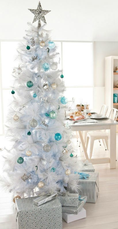 Tall White Coastal Beach Christmas Trees with Seahorse and Fish Glass Ornaments. Featured on Completely Coastal: http://www.completely-coastal.com/2013/11/white-Christmas-trees-beach-coastal.html