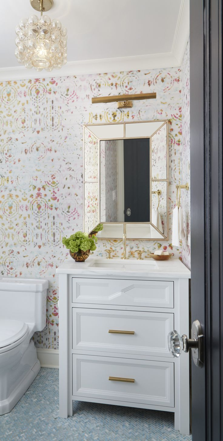 Power Room with Eclectic Wallpaper and Brass Finishes