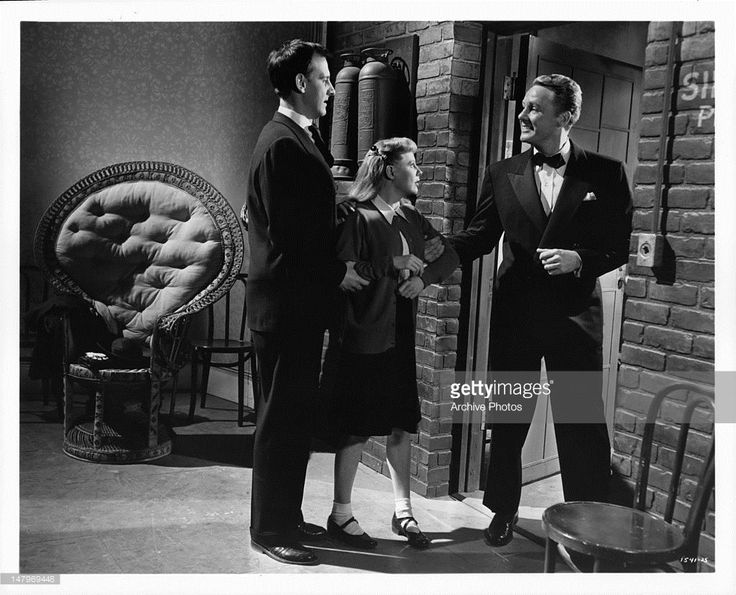 June Allyson finds herself to be a hotly contested bit of property between Hans Conried and Van Johnson in a scene from the film 'Too Young To Kiss', 1951.
