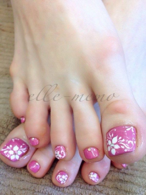 Pink polish, White Flower with Rhinestone and Swirl Design.
