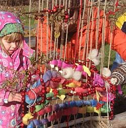outdoor loom - weave tried flowers, cranberries, twigs and more for birds and wild life to eat and build nests with
