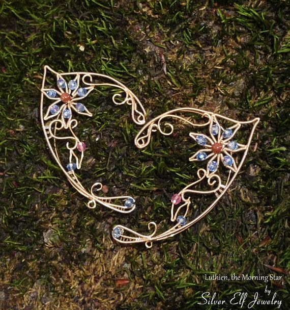 Lúthien Elf Ears by SilverElfJewelry on Etsy, $52.00. The lady who makes these is seriously the most talented ear cuff artist on all of Etsy. Such delicate work! She obviously has an artist's sensibility.
