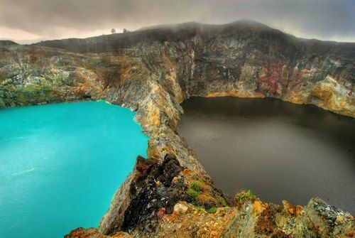 The Lakes of Mount Kelimutu, Indonesia are considered to be the resting place for departed souls ~ the lakes are locally referred to as 'The Lakes of evil spirits.' All three lakes change colour from blue to green, black or red unpredictably.