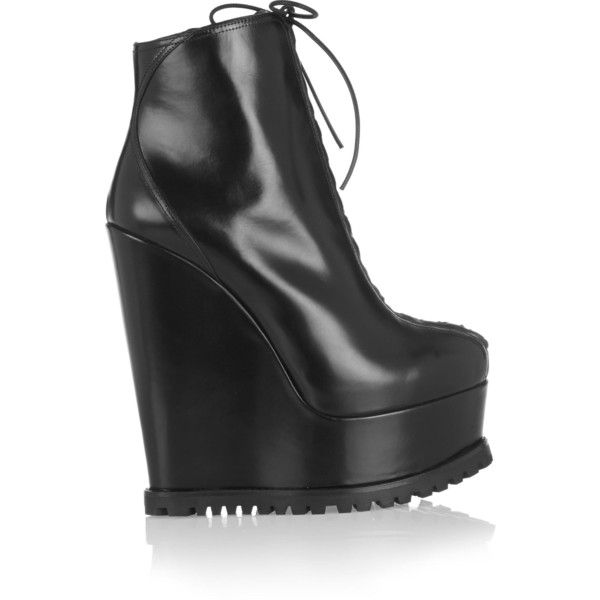 ALAÏA  Leather wedge ankle boots ($620) ❤ liked on Polyvore featuring shoes, boots, black wedge bootie, ankle boots, lace-up platform boots, black platform boots and wedge boots