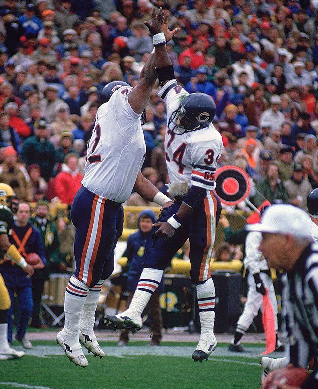 Bears teammates Walter Payton and William Perry high five after a Nov. 1985 victory over the Packers. The Bears would go onto win the Super Bowl two months later. (John Biever/SI)  GALLERY: Rare Photos of the 1985 Chicago BearsBANKS: NFL Power RankingsKING: Team-by-team previews