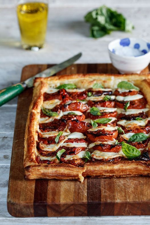 Light, flaky pastry topped with milky mozzarella and sweet, roasted tomatoes topped with fresh basil.