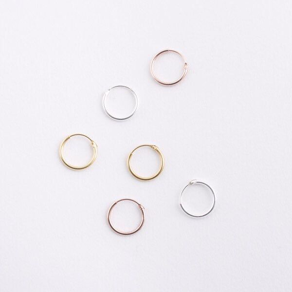 We've got a great range of sterling silver, gold and rose gold planted small hoop earrings in stock. Find yours here: www.hopscotchlondon.com/product-category/jewellery