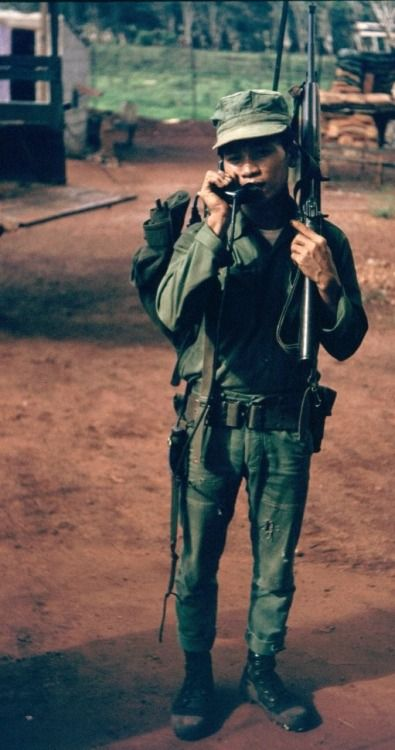 ARVN radio telephone operator, 1968. Poor guy - no flak jacket or helmet and carrying a puny M1 carbine - it's a wonder they fought as well as they did ...